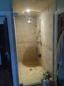 travertine shower stall by Terrazzo Creations Inc